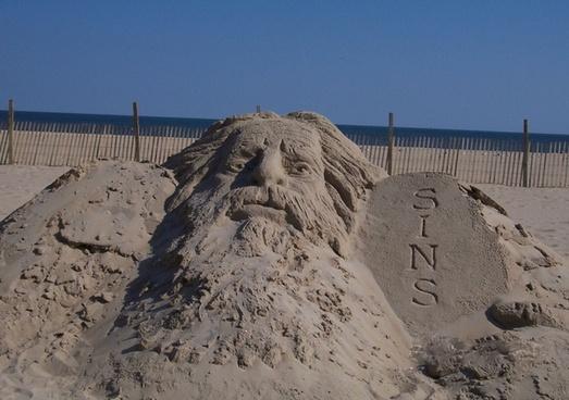 jesus sin sand sculpture