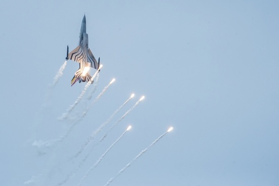 jet fighter with flares