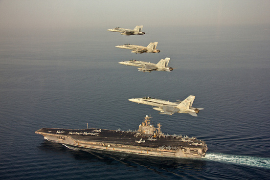 jets fly in formation above uss abraham lincoln