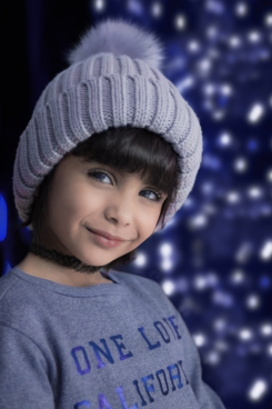 cute small girl with woolen hat