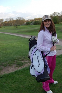lady golfer and bag