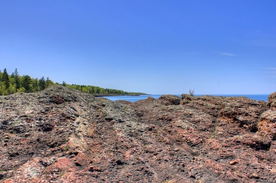 lake superior beyond rock outcropping in the upper peninsula michigan