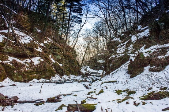landscape view with snow in the gorge in parfreys glen wisconsin