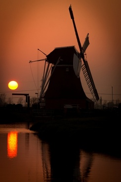 landscape with dutch mill at sunset
