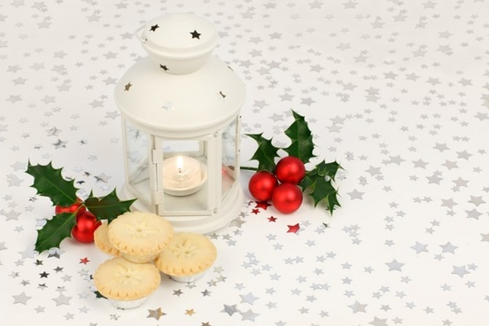 lantern with holly and mince pies