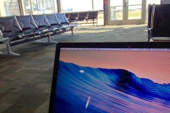 laptop at empty airport
