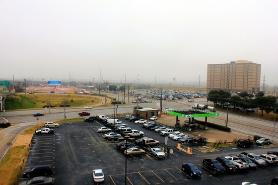 large parking lot on foggy day in dallas texas