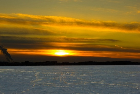 large sunset over snowy mendota in madison wisconsin