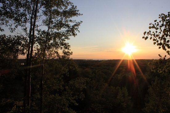 late afternoon sun shining over valley at potawatomi state park wisconsin
