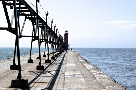 lighthouse at end of pier on lake