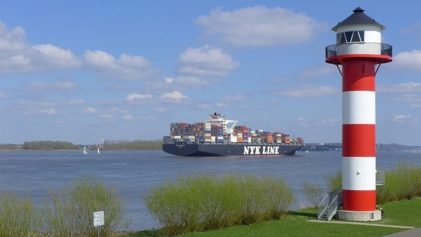 lighthouse container ship river
