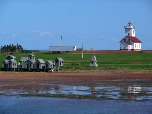 lighthouse old fishing huts shoreline