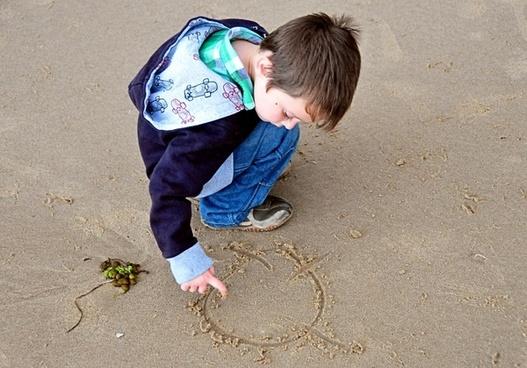 little boy child sand