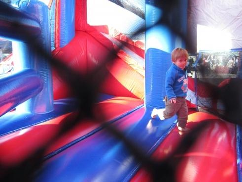 little boy on jumping castle