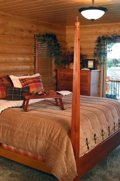 log home master bedroom bed