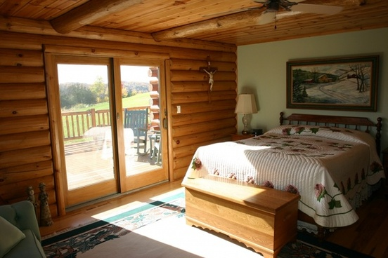 log home master bedroom bed