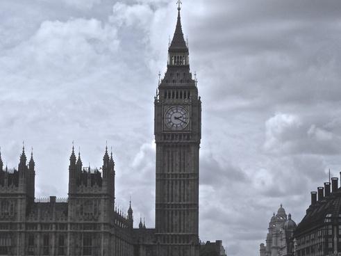 london clock tower against gloomy sky