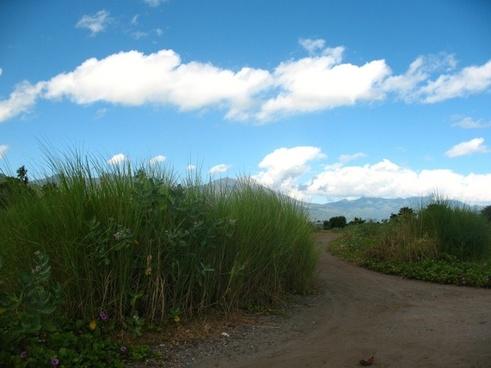 long road cloud sky