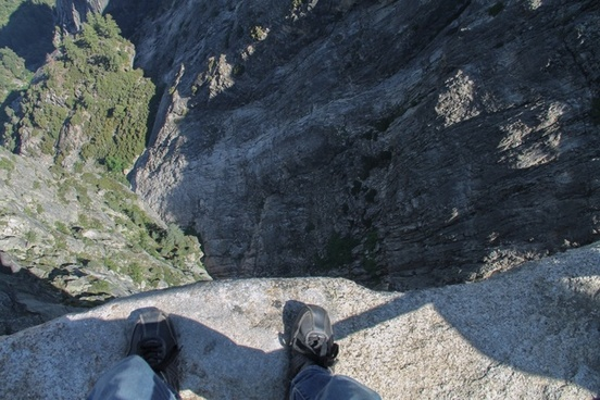 looking down at feet on edge of cliff