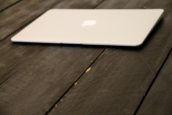 macbook air laptop on wood boards