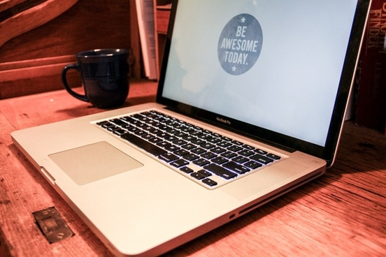 macbook laptop with 8220be awesome8221 screen with coffee mug
