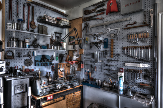 machine room wall with lathe tooling and metal chop saw