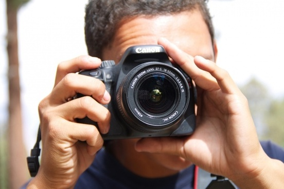 man8217s head taking picture with dlsr camera