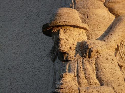 man hat faces