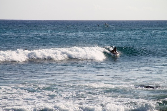 man riding boogie board on wave