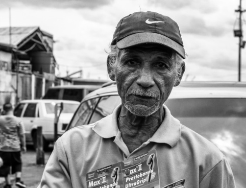 man selling razors black and white