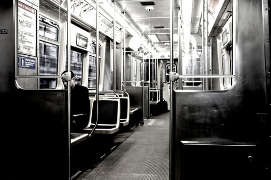 man sitting alone in empty train