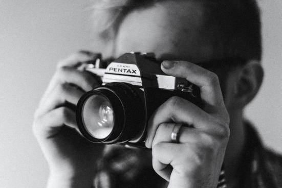 man using retro camera