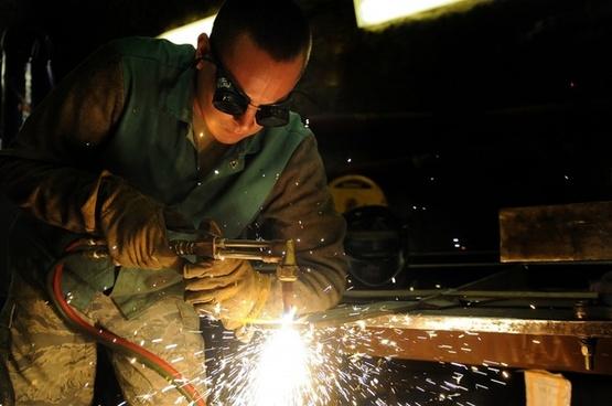 man welding industrial