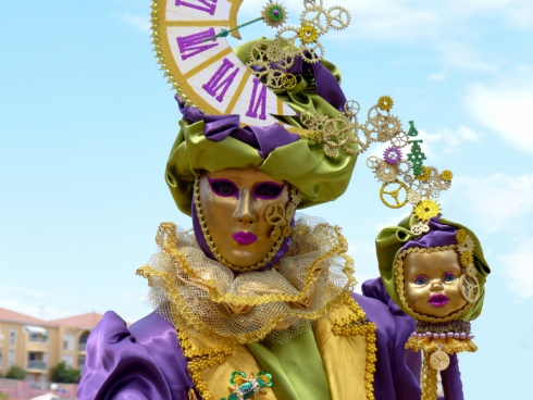 performer with golden masks and colorful costume