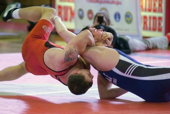 men wrestling sports