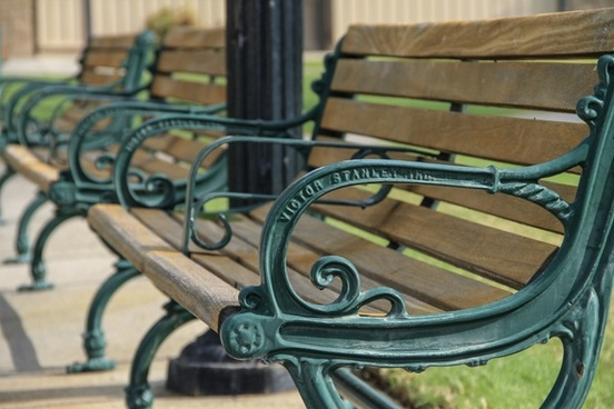 metal 038 wood park benches in row