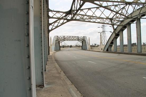 metal frames over street bridge