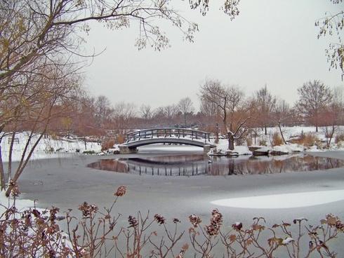monet bridge in snowcovered park