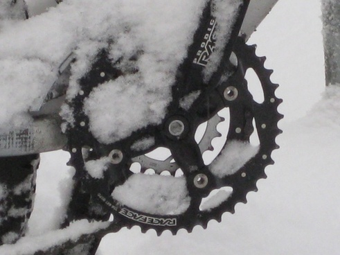 mountain bike snowed in snow
