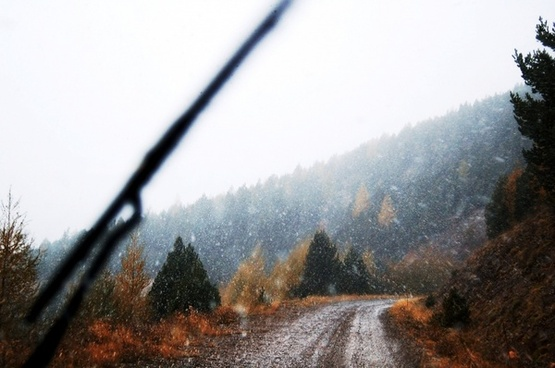 mountain road snowing snow