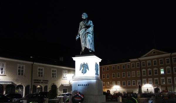mozart statue in salzburg at night