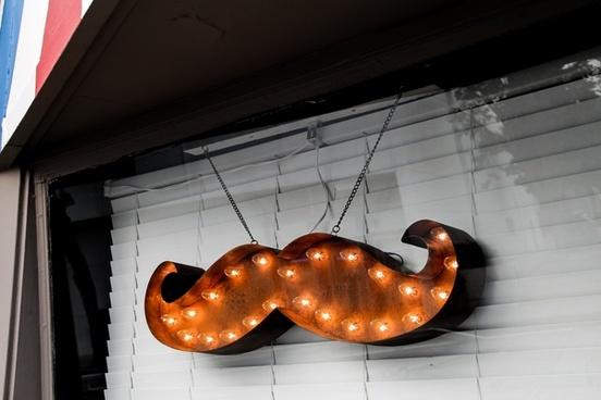 mustache light marquee in window