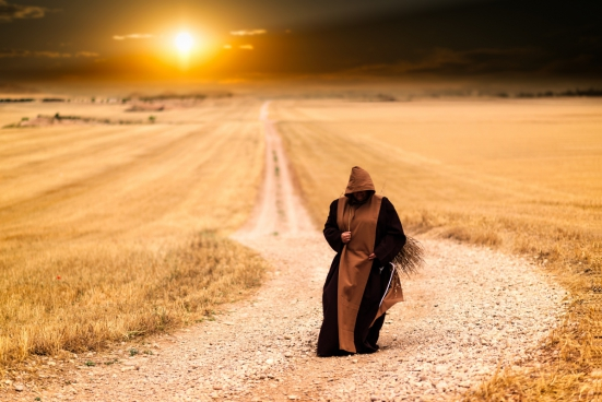 mysterious monk walking alone during sunset