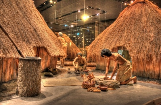 native americans working besides houses at cahokia mounds illinois