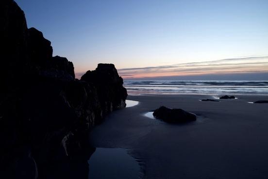 nature landscape beach sunrise ocean rocks sand
