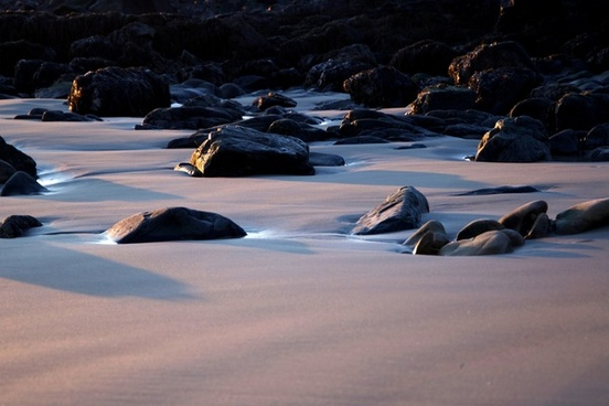 nature ocean beach rocks sand sunlight sea