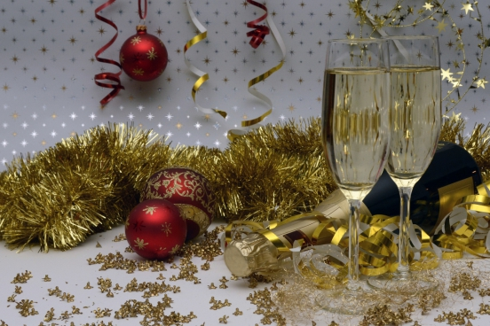 christmas celebration with baubles and wine glasses