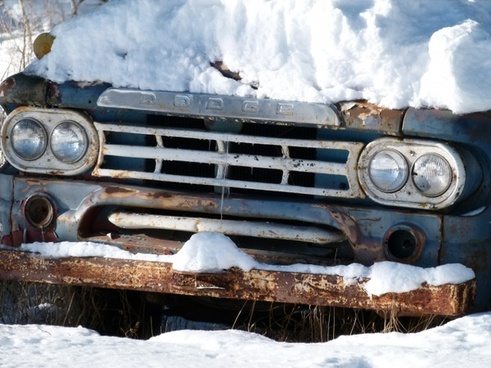 old automobile snow covered