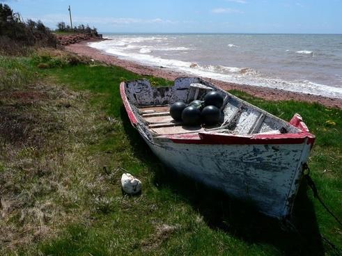 old fishing boat beach shoreline