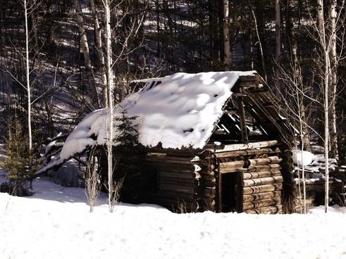 old log cabin winter snow